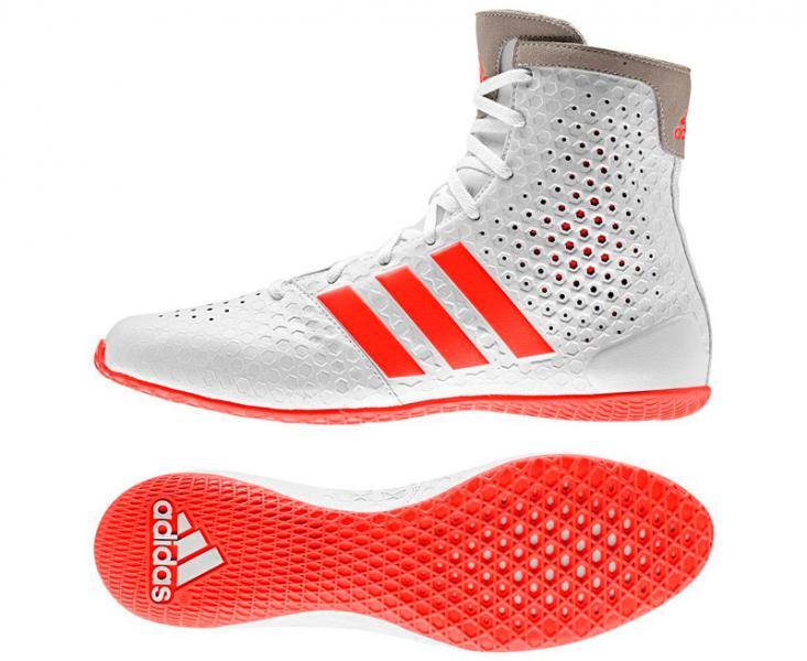 Боксерки KO Legend 16.1 бело-красные AdidasБоксерки<br>Боксерки adidas KO LEGEND- отличается высокой прочностью, комфортом и отличной вентиляцией. Внутренняя прочная сетка, которая обеспечивает вентиляцию, отлично выделены и приспособлены как дизайн, который действительно пришелся к месту. Гибкая, анатомически правильная конструкция боксерок позволяет ноге с легкостью сгибаться, а так же способствует большей амплитуде движения ноги. Благодаря технологии climacool® 360°,имеют превосходную вентиляцию ноги во время интенсивных тренировок. Верхняя часть боксерок выполнена из комбинации полиуретана и искусственной замши в верхней части обуви, тем самым способствует более плотной фиксации и обеспечивает комфортную посадку. Безопасная шнуровка по центру способствует плотной и удобной посадке боксерок на ноге.  Мягкая, внутренняя стелька и промежуточная подошва выполнены из легкого, упругого пеноматериала, который эффективно амортизирует ударную нагрузку, воздействующую на стопу и голеностопный сустав при активном передвижении по рингу. Цельная подошва с технологиейadiPRENE®+ в состав которой входитсверхупругий материал, который служит одной цели: создать максимальное усилие в области носка в момент отталкивания. Использование этой технологической разработки позволяет атлету значительно повысить скорость и эффективность выполнения движений. Состав: 100% синтетика. ТехнологияadiPRENE®+. Технология climacool® 360°. Прочный верх из плотной дышащей сетки поддерживает комфортный микроклимат и отводит излишки тепла и влаги. Z-образное усиление пяточной зоны для поддержки средней части стопы и лучшей устойчивости. Надежная система шнуровки. Стелька EVA, обеспечивает великолепную амортизацию и создает равномерное распределение нагрузок по поверхности подошвы ступни. Износостойкая подошва ADIWEAR™ для отличного сцепления с гладкой поверхностью ринга. Состав: 100% полиуретан верха боксерок. Дышащие вставки, которые обеспечивают отличную вентиляцию.<br><br>Размер INT: 39 [UK 7]