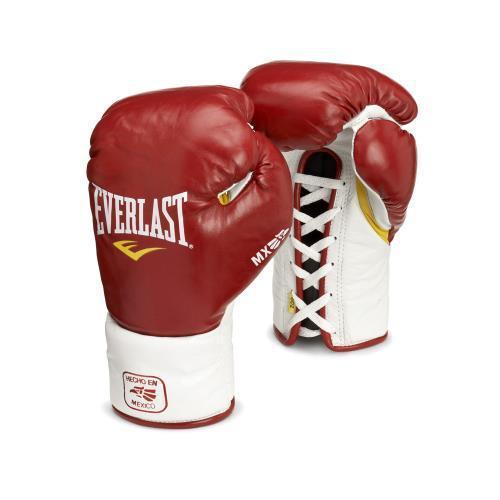 Перчатки боксерские боевые Everlast MX Pro Fight, 10 OZ EverlastБоксерские перчатки<br>Перчатки MX Professional Fighting Gloves , подойдут для соревнований любого уровня, вплоть до боев за звание чемпиона мира. Как и вся серия MX, они сделаны индивидуально в Мексике из превосходной кожи Piel Planchada. В качестве набивки используется конский волос и пенистый наполнитель. Фиксация на руке осуществляется классической шнуровкой.<br>