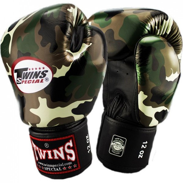 Перчатки боксерские Twins FBGV-JG, 16 унций  Twins SpecialБоксерские перчатки<br>Перчатки боксерскиеTwins FBGV-JGпрекрасно подойдут для тайского бокса, кикбоксинга или классического бокса. Особенности:- Натуральная кожа высшего качества- Удобная застежка на липучке- Идеальное соотношение цена/качество- Фиксированный большой палец- Внутренний материал из многослойной высококачественной пены- Ручная работа- Страна производитель: Тайланд<br>