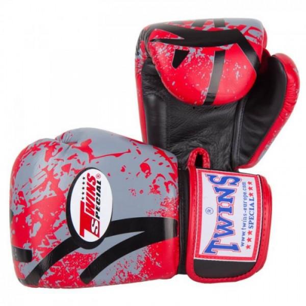 Перчатки боксерские Twins FBGV-38-Red, 16 унций  Twins SpecialБоксерские перчатки<br>Перчатки боксерские Twins FBGV-38B-Red прекрасно подойдут для тайского бокса, кикбоксинга или классического бокса. Особенности:- Натуральная кожа высшего качества- Удобная застежка на липучке- Идеальное соотношение цена/качество- Фиксированный большой палец- Внутренний материал из многослойной высококачественной пены- Ручная работа<br>