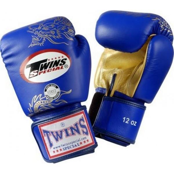 Перчатки боксерские Twins FBGV-6G-Blue, 12 унций  Twins SpecialБоксерские перчатки<br>Перчатки боксерские Twins FBGV-6G прекрасно подойдут для тайского бокса, кикбоксинга или классического бокса. Особенности:- Натуральная кожа высшего качества- Удобная застежка на липучке- Идеальное соотношение цена/качество- Фиксированный большой палец- Внутренний материал из многослойной высококачественной пены- Ручная работа<br>