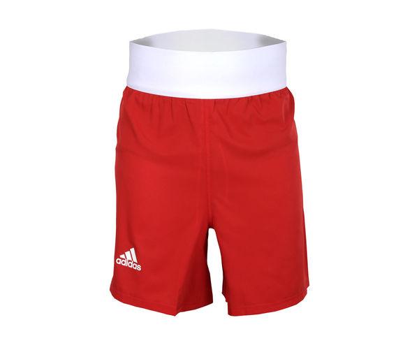 Шорты боксерские AIBA Competition Boxing Short, Красные AdidasШорты для бокса<br>Шорты боксерскиеadidas AIBA, стандарт Олимпийской боксерской формы. Удобные боксерскиешорты из мягкой 100% полиэстера,который эффективно отводит влагу от тела во время тренировки, а такжеобладает абсорбирующими свойствами и быстро высыхает. Благодаря высокопрочному материалу, шорты будут служить долго и выглядеть как новые. Свободный крой не стесняет движений и позволяет эффективно отрабатывать технику. Материал:100% полиэстерЭластичная резинка на шортах отлично держится и не доставляет дискомфорт. Классический вариант формы для занятий боксомСвободный покройМягкий и легкийматериалСтандарт для выступленийУдобная силиконовая полоска на шортах чтобы майка не выпадала из шорт.<br>