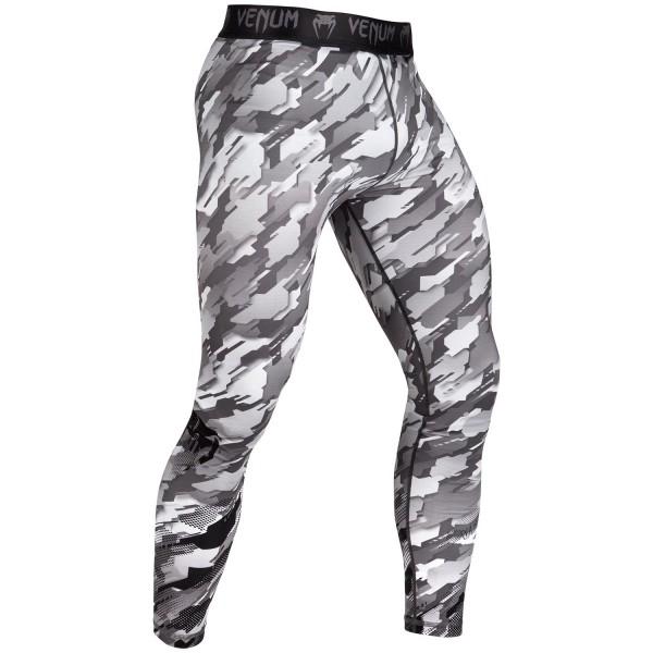 Компрессионные штаны Venum Tecmo - Grey VenumКомпрессионные штаны / шорты<br>Компрессионные штаны Venum Tecmo - GreyПрочный материал, который облегает тело как вторая кожа - то, что нужно для тренировок. Компрессионная технология поддерживает мышцы, улучшает кровообращение, повышая их эффективность. Технология Dry Tech эффективно вывожит влагу. Особенности:- 87% полиэстер/13% спандекс- компрессионная технология- технология Dry Tech- рисунок сублимирован в волокно- эргономичные усиленные швы и эластичный пояс<br><br>Размер INT: L
