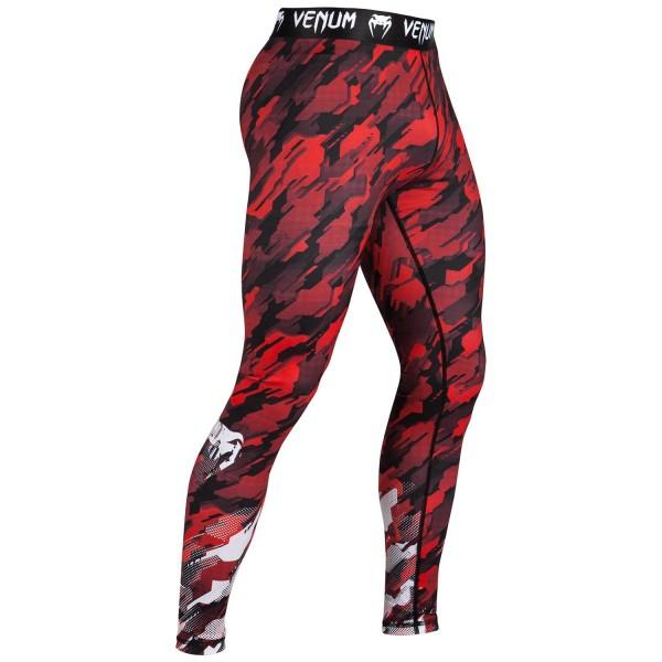 Компрессионные штаны Venum Tecmo - Red VenumКомпрессионные штаны / шорты<br>Компрессионные штаны Venum Tecmo - RedПрочный материал, который облегает тело как вторая кожа - то, что нужно для тренировок. Компрессионная технология поддерживает мышцы, улучшает кровообращение, повышая их эффективность. Технология Dry Tech эффективно выводит влагу. Особенности:- 87% полиэстер/13% спандекс- компрессионная технология- технология Dry Tech- рисунок сублимирован в волокно- эргономичные усиленные швы и эластичный пояс<br><br>Размер INT: S