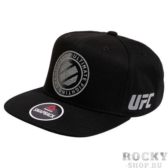 Бейсболка Reebok UFC ReebokБейсболки / Кепки<br>Снепбэк (бейсболка) Reebok UFC. Дизайн, созданный в коллаборации Reebok и UFC. Размер бейсболки регулируется. Состав: 97% хлопок, 3% спандекс.<br>