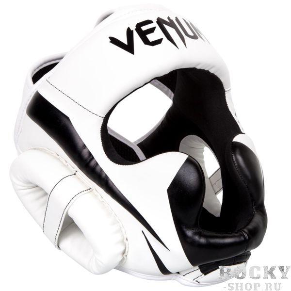 Боксерский шлем Venum Elite VenumБоксерские шлемы<br>Боксерский шлем Venum Elite. Очень мягкая, приятная тканевая подкладка. Рисунок на липучке сделан методом штамповки. Специальный наполнитель(пена) обеспечивает максимальную амортизацию при ударе, а соответственно защищает лицо(голову). Помимо защиты самой головы, шлем так же защищает щеки и уши. Размер универсальный. Крепление - двойная застежка на задней части шлема. Полная защита головы, скул, ушей. Внешняя обивка: Premium Skintex Leather! Сделано в Тайланде.<br>