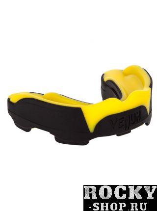 Капа боксерская Venum Predator Mouthguard Black/Yellow VenumБоксерские капы<br>Капа Venum Predator Mouthguard - новый эталон среди кап в сочетании с идеальной посадкой, гибкостью и высокой защитой. <br><br>Усовершенствованная форма обеспечивает максимально четкую посадку на зубы, в то время как низкопрофильных дизайн облегчает дыхание и позволяет говорить со спарринг-партнером или тренером. <br><br>Двухъядерный дизайн дает интеллектуальную защиту от удара: сначала поглощает наиболее мощную часть удара, а затем рассеивает ударную волну в направлении наиболее крепких частей вашей челюсти. <br><br>Для того, чтобы соответствовать ожиданиям каждого бойца, капа Хищник была разработана в сотрудничестве с лучшими бойцами UFC, а именно Жозе Альдо и Лиото Мачида. <br><br>Характеристики:<br><br><br>гелевый слой Nextfit для точной посадки и комфорта<br><br>многослойная конструкция дает отличную амортизацию удара<br><br>специальная форма, обеспечивающая оптимальное дыхание во время тренировок или соревнований<br><br>специальный футляр в комплекте<br><br>испытано и используется бойцами UFC<br><br>СЕ сертификация<br>