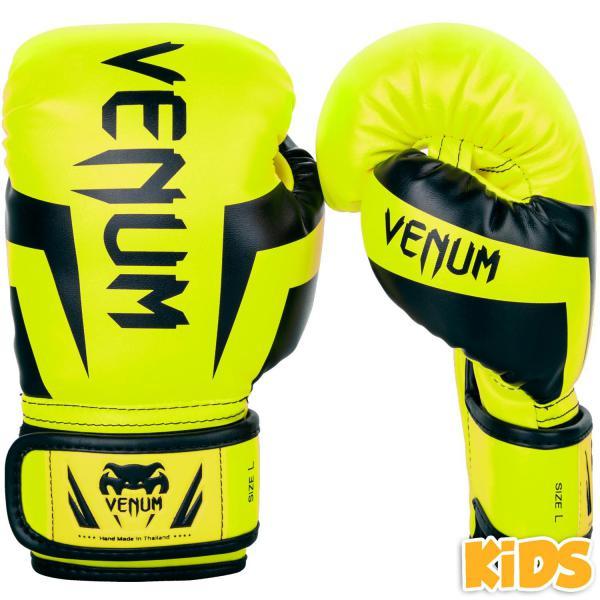 Детские перчатки Venum Elite, yellow/black, M size, 6 OZ VenumБоксерские перчатки<br>Детские боксерские перчатки Venum Elite. Выполнены с учетом физиологического строения детских и юношеских рук. Высококачественный наполнитель(пена) снижает силу удара, тем самым защищает кисть бойца и лицо его партнера. Широкая застежка, обеспечивающая надежную фиксацию перчаток Venum на запястье. Так же застежка снабжена резиновой вставкой, для регулирования обхвата кисти. Очень качественно сделанные швы. Внешний материал детских перчаток для бокса Venum Elite - Premium Skintex Leather. Внутренний наполнитель - пена для лучшей амортизации удара.<br>