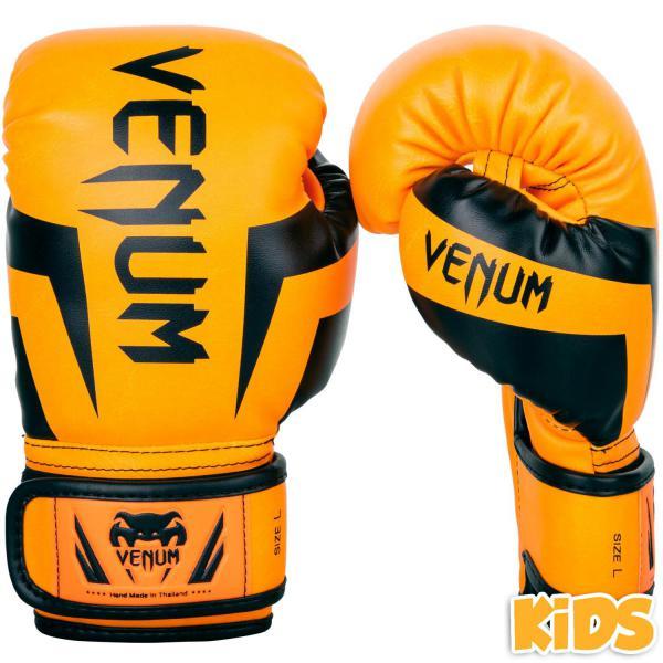Детские перчатки Venum Elite, orange/black, M size, 6 OZ VenumБоксерские перчатки<br>Детские боксерские перчатки Venum Elite. Выполнены с учетом физиологического строения детских и юношеских рук. Высококачественный наполнитель(пена) снижает силу удара, тем самым защищает кисть бойца и лицо его партнера. Широкая застежка, обеспечивающая надежную фиксацию перчаток Venum на запястье. Так же застежка снабжена резиновой вставкой, для регулирования обхвата кисти. Очень качественно сделанные швы. Внешний материал детских перчаток для бокса Venum Elite - Premium Skintex Leather. Внутренний наполнитель - пена для лучшей амортизации удара.<br>