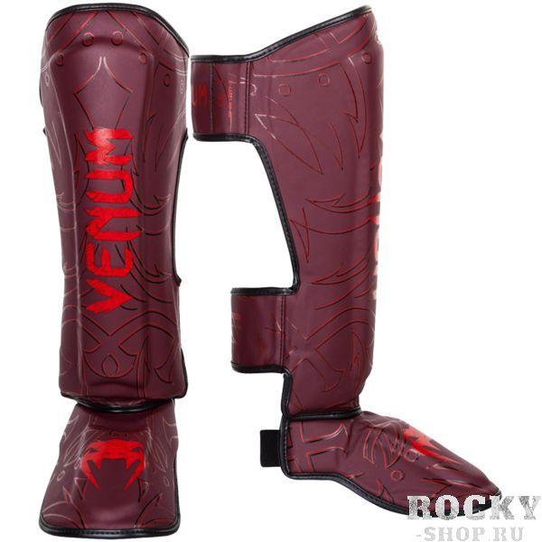 Шингарды Venum Nightcrawler Red VenumЗащита тела<br>Тайские шингарды (накладки на ноги) Venum Nightcrawler. Данный вид шингард предназначен для особо сильной работы ногами, поэтому они пользуются популярностью у бойцов тайского бокса и K-1. Накладки Venum - идеальное сочетание качества, стиля и комфорта. Шингарды надежно защищают и голень, и стопу! Наполнитель: пена, снижающая силу удара. Внешняя обивка: Semi Leather! Все швы тщательно укреплены. Внутренняя обивка: приятная ткань. Великолепно облегают ногу не создавая какого-либо дискомфорт бойцу. Крепятся с помощью двух ремней-липучек. Сделано в Тайланде, ручная работа! Продаются парой.<br><br>Размер: XL