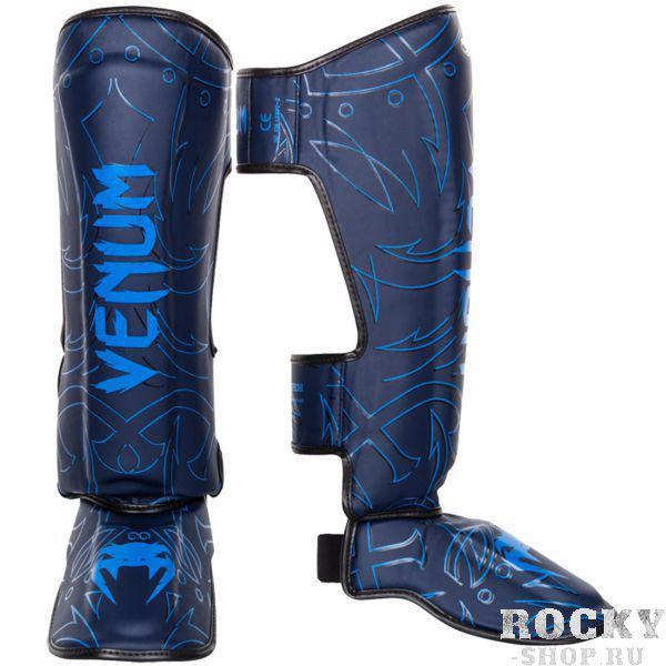 Шингарды Venum Nightcrawler Navy Blue VenumЗащита тела<br>Тайские шингарды (накладки на ноги) Venum Nightcrawler. Данный вид шингард предназначен для особо сильной работы ногами, поэтому они пользуются популярностью у бойцов тайского бокса и K-1. Накладки Venum - идеальное сочетание качества, стиля и комфорта. Шингарды надежно защищают и голень, и стопу! Наполнитель: пена, снижающая силу удара. Внешняя обивка: Semi Leather! Все швы тщательно укреплены. Внутренняя обивка: приятная ткань. Великолепно облегают ногу не создавая какого-либо дискомфорт бойцу. Крепятся с помощью двух ремней-липучек. Сделано в Тайланде, ручная работа! Продаются парой.<br><br>Размер: L