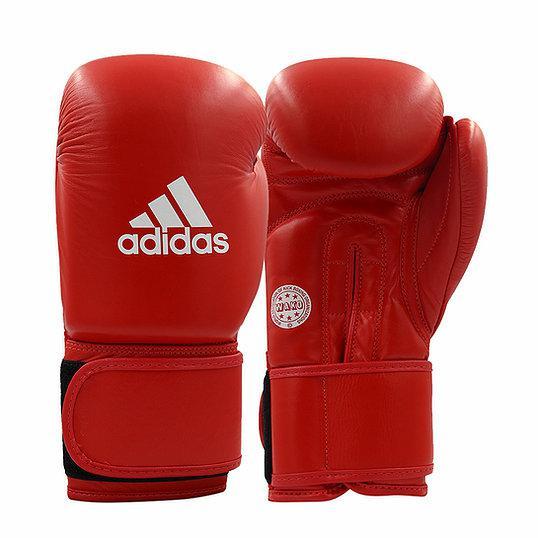 Перчатки для кикбоксинга WAKO Kickboxing Training Glove красные AdidasБоксерские перчатки<br>Соревновательные перчатки WAKO кикбоксинг. Модельиз 100%полиуретанадля выступлений по кикбоксингу WAKO. Набивка имеет композитную структуру, выполненную по технологииI-Protech ®- это композитный литой вкладыш из пены высокого давления IMF (Intelligent MouldFoamTechnology),которыйобеспечивает однородный уровень поглощения удара,что гарантирует идеальную защиту для ваших рук. Одобрено WAKO (нанесено на ладонь). Фиксация перчатки системой липучкидля быстрой и точной регулировки боксерских перчаток.  Состав: 100% Полиуретан Технология PU3GINNOVATIONТехнология I-Protech ®Одобрено WAKO. Одобрено Федерацией Кикбоксинга РоссииСпециальная усиленная манжета100% полиуретан.<br><br>Размер: 10 унций