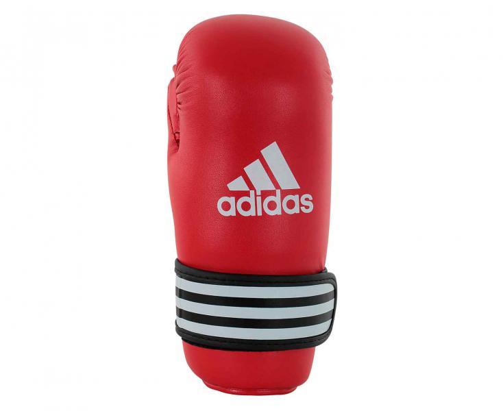 Перчатки полуконтакт WAKO Kickboxing Semi Contact Gloves красные, красные AdidasЭкипировка для кикбоксинга<br>Перчатки полуконтакт для кикбоксинга, одобрены WAKO. Они изготовлены из полиуретана нового поколения по технологии PU3G INNOVATION. PU3G - этомягкий и прочныйполиуретан, который выглядит, как кожа, и нечувствителен к колебаниям температуры и влажности. Внутренний вкладышсделаниз многослойного литого блока пенывысокого давления IMF (Intelligent Mould Technology),которыйобеспечивает однородный уровень поглощения удара. Эта технологиягарантирует идеальную защиту для руки, а также безопасность для партнера по тренировке. Внутренний материалI-COMFORT+ ® обладает антиаллергенными и антискользящими свойствами и моментально испаряет жидкость с внутренней поверхности перчаток. Усиленная защита большого пальца, кисти и ударной зоны. Специальная жесткая манжета для защиты кисти с фиксацией ремешком на липучкешириной 5 см. Состав: 100% полиуретан. Технология PU3GINNOVATION ®Технология I-Protech ®I-COMFORT+ ®Одобрено WAKO (Мировая Федерация Кикбоксига)Одобрено Федерацией Кикбоксинга РоссииПолностью литой блок пены до запястьяУсиленная защита большого пальца, кисти и ударной зоны100% полиуретан<br><br>Размер: M