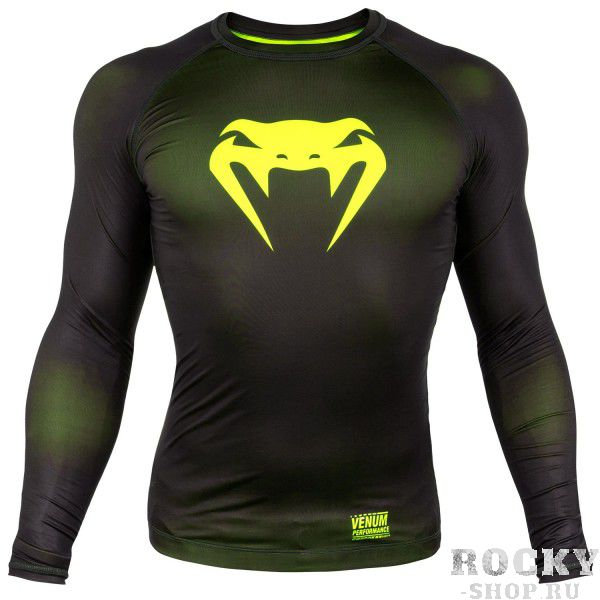 Компрессионная футболка Venum Contender 3.0 Black/Yellow L/S VenumРашгарды<br>Компрессионная футболка Venum Contender 3. 0 Black/Yellow L/S идеально садится на тело за счет материала из смеси полиэстера и спандекса. Защищает от мелких травм, раздражений, микробов. Оригинальный дизайн продукта обеспечивает вам непревзойденный стиль. Особенности:- Сделано в Китае- Состав - 87% полиэстер/13% спандекс - эластичная и прочная ткань- Компрессионная технология улучшает кровообращение в мышцах и ускоряет восстановление- Рисунок полностью сублимирован в ткань- Усиленные швы- Силиконовая полоса на талии предотвращает задирание<br><br>Размер INT: XL