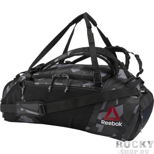 Сумка-рюкзак Reebok UFC ReebokСпортивные сумки и рюкзаки<br>Сумка-рюкзак Reebok UFC Ultimate Fan Convertible Grip. 100% полиэстер, гладкий тканый материал. Регулируемые ремни — спортивная сумка трансформируется в рюкзак. Отделения для одежды и обуви. Сетчатые вставки в основном отделении для вентиляции. Подкладка с антибактериальной обработкой.<br>