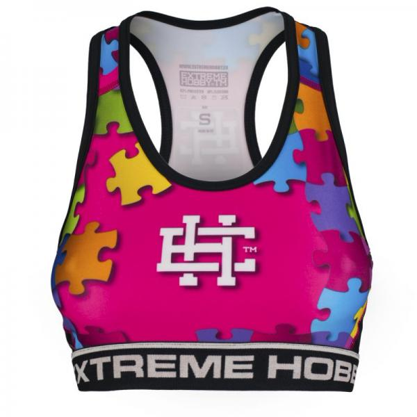 Топ женский PUZZLE (розовый) Extreme HobbyМайки<br>Отличного качества женский топ Extreme Hobby является идеальным выбором для людей, активно занимающихся тренировками, которые ценят высокий класс продуктов. Изготовлен из современного материала, который благодаря своей структуре идеально садится по фигуре. Продуманная система терморегуляции, с помощью которого тело остается сухим, а мышцы разогретыми. Логотипы нанесены по технологии сублимации. Специальная резинка под грудью предотвращает скольжение во время занятий спортом. <br>КОЛЛЕКЦИЯ: SPORT<br>ЦВЕТ: РОЗОВЫЙ<br>МАТЕРИАЛ: 82% ПОЛИЭСТЕР 18% ЭЛАСТАН<br><br>Размер INT: L