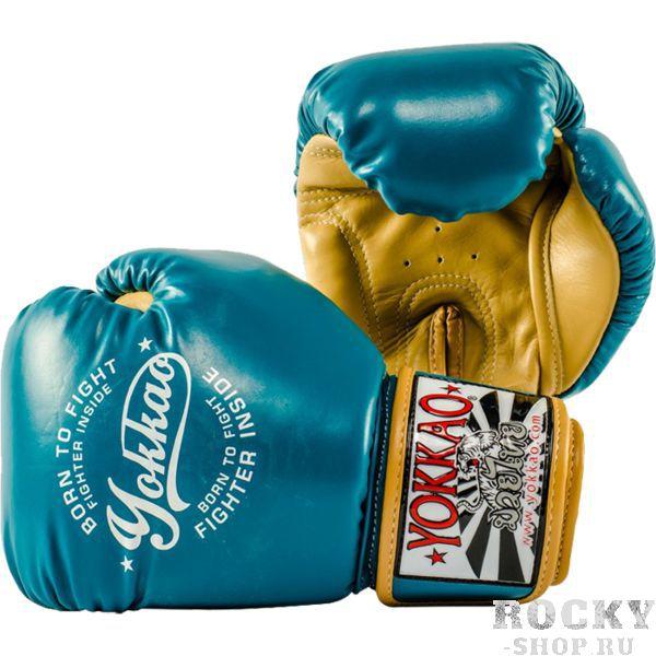 Боксерские перчатки Yokkao Vintage Blue, 12 oz YokkaoБоксерские перчатки<br>Боксерские перчатки Yokkao Vintage Blue. Yokkao - один из лидеров по производству экипировки для тайского бокса. Данные перчатки подойдут и для работы на мешках, и на лапах, и для работы в самых жестких спаррингах. Внутри перчатки наполнены пеной, которая хорошо гасит силу ударов и не дает рукам травмироваться. Большой палец на перчатки зафиксирован. Данные перчатки для бокса выполнены из кожи КРС. Запястье надёжно фиксируется манжетой. Сделаны вручную в Таиланде.<br>
