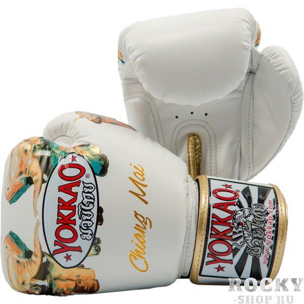 Боксерские перчатки Yokkao Chiang Mai, 12 oz YokkaoБоксерские перчатки<br>Боксерские перчатки Yokkao Chiang Mai. Yokkao - один из лидеров по производству экипировки для тайского бокса. Данные перчатки подойдут и для работы на мешках, и на лапах, и для работы в самых жестких спаррингах. Внутри перчатки наполнены пеной, которая хорошо гасит силу ударов и не дает рукам травмироваться. Большой палец на перчатки зафиксирован. Данные перчатки для бокса выполнены из кожи КРС. Запястье надёжно фиксируется манжетой. Сделаны вручную в Таиланде.<br>