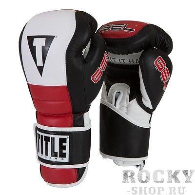 Боксерские перчатки Title Gel Rush, 14 OZ TITLEБоксерские перчатки<br>Боксерские тренировочные перчатки Title Gel Rush Training Gloves. Выполнены из износостойкой натуральной кожи премиум-класса. Внутренний наполнитель, в сочетании геля с пеной, обеспечивает отличное поглощение удара, тем самым обеспечивая надежную защиту вашим рукам, а так же безопасность вашему спарринг партнеру. Невероятно удобная посадка, благодаря анатомически правильному крою и приятной на ощупь внутренней подкладке. Революционный покрой манжеты дают отличную поддержку кисти руки и ее фиксацию. Нейлоновая вентилирующая вставка на ладони, удаляет избыточную влагу из перчатки, вентилируя подкладку.<br>
