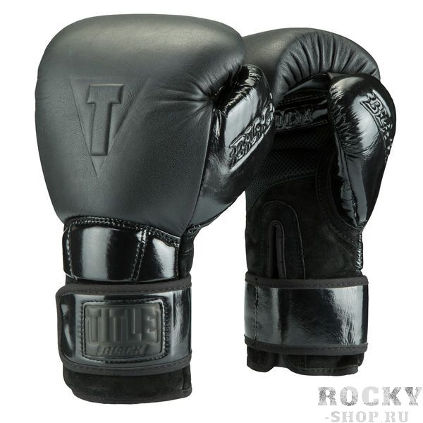 Боксерские перчатки Title Black Fierce, 12 OZ TITLEБоксерские перчатки<br>Премиальные боксерские перчатки Title Black Fierce Training Gloves сочетают в себе высокое качество используемых материалов, точный и аккуратный пошив, высокую надежность и комфорт в работе. Внешний материал это сочетание двуслойной крупнозернистой кожи высшего качества, бархатной замши и лакированной кожи. Логотипы Title Black на манжете, большом пальце и кулаке выполненные тиснением черного цвета. Эти перчатки наполнены высокотехнологичной пеной, поглощающей удар, с памятью (запоминает форму руки). Вшитые вставки из сетки для максимальной вентиляции ладоней и зоны большого пальца обеспечивают комфортную работу. Удлиненный манжет выступает как второй бинт, он крепко держит запястье и обеспечивает максимальную защиту. В тоже время, изгиб сверху манжеты дает возможность сгибать кисть ровно на столько, на сколько это нужно.<br>
