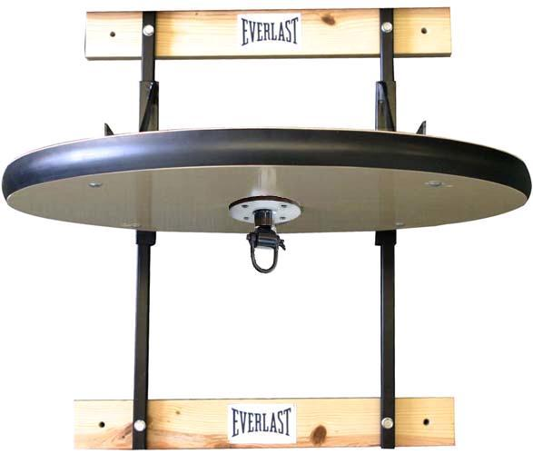 Платформа для скоростной груши Everlast Deluxe Adj EverlastСнаряды для бокса<br>Adjustable Speed Bag Platform с безболезненностью устанавливается на стену и превосходно подойдет как для профессионалов, так и для начинающих атлетов. Для полной безопасности платформа по всей окружности обита резиновым уплотнителем и просто регулируется по высоте. Металлические части изготовлены из прочной металла со специальным порошковым покрытием для защиты от царапин. В набор входят шарнирное крепление, две деревянные распорки и все необходимые для установки композиты. Adjustable Speed Bag Platform направлена для установки скоростной груши, однако совместима с грушами или канатом двойного (пол - потолок) крепления.<br>