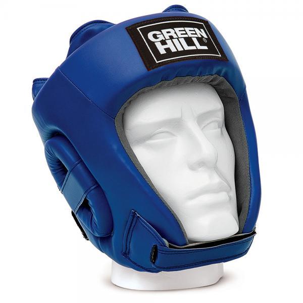 Шлем Green Hill training, Синий Green HillБоксерские шлемы<br>Соревновательный шлем TRAINING это более доступная версия шлема FIVE STAR. Внешняя сторона шлема выполнена из 100% полиуретана, внутренняя сторона из искусственной замши AMARA. Уши спортсмена дополнительно защищены пенными модулями. Подбородок на ремешке с липучкой. Затылок на двойном встречном замке с липучкой. Верх шлема на шнуровке. - Соревновательный шлем- 100% полиуретан- Внутренняя сторона из искусственной замши AMARA<br><br>Размер: L