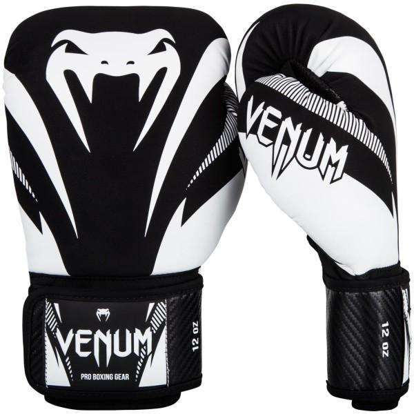 Перчатки боксерские Venum Impact Black/White, 16 унций VenumБоксерские перчатки<br>Перчатки боксерские Venum Impact Black/White изготовлены вручную из премиальной синтетической кожи Skintex. Усиленные швы и внутренняя подкладка обеспечивают долговечность и комфорт при любых ударах. Пена высокой плотности обеспечивает улучшенную амортизацию при ударах. Большой палец надежно защищен. Оригинальный и яркий дизайн. Особенности:- трехслойная внутрення пена высокой плотности- защита большого пальца<br>