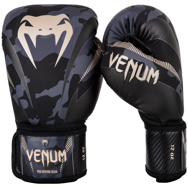 Перчатки боксерские Venum Impact Dark Camo/Sand, 16 унций VenumБоксерские перчатки<br>Перчатки боксерские Venum Impact Dark Camo/Sand изготовлены вручную из премиальной синтетической кожи Skintex. Усиленные швы и внутренняя подкладка обеспечивают долговечность и комфорт при любых ударах. Пена высокой плотности обеспечивает улучшенную амортизацию при ударах. Большой палец надежно защищен. Оригинальный и яркий дизайн. Особенности:- трехслойная внутрення пена высокой плотности- защита большого пальца<br>