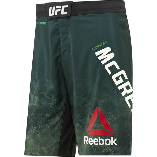 Шорты Reebok McGregor ReebokШорты ММА<br>Бойцовские шорты Reebok UFC Conor McGregor Octagon. Официальные шорты Конора The Notorious Макгрегора от Reebok UFC. Материал: полиэстер / эластан, тканый материал для эластичности, комфорта и полной свободы движений. Пояс на удобной застежке-липучке. Технология Speedwick эффективно отводит лишнюю влагу, обеспечивая сухость и комфорт. Разрезы по бокам и эластичная в 4-х направлениях ткань гарантируют полную свободу движений. Уход: машинная стирка в холодной воде, не отбеливать.<br><br>Размер INT: S
