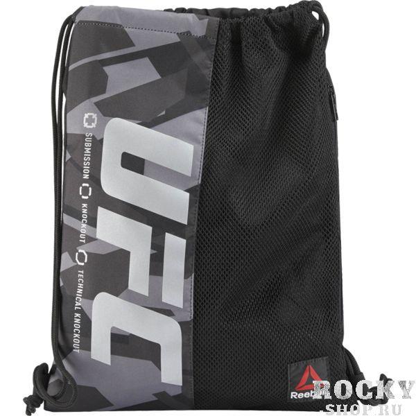 Сумка UFC Ultimate Fan ReebokСпортивные сумки и рюкзаки<br>Сумка UFC Ultimate Fan. Лёгкий спортивный мешок для переноски экипировки. Прекрасно послужит как для походов в спортзал, так и для поездок на отдых и в путешествиях. Отлично подойдет для переноски ги, обуви, одежды, перчаток. Удобный внутренний карман для мелочей. Сетчатый карман на молнии спереди. Верх сумки затягивается двумя контрастными шнурками. Габариты: 34 х 45 см, объем 10 л. Материал: 100% полиэстер.<br>