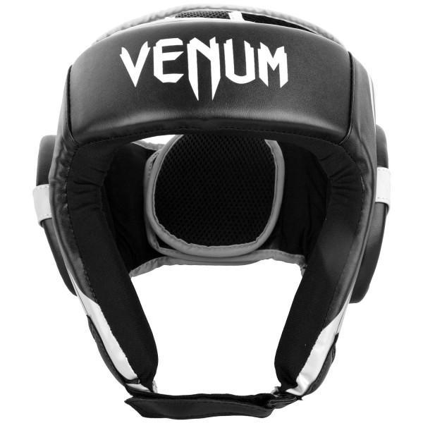 Шлем боксерский Venum Challenger 2.0 Open Face Black/White VenumБоксерские шлемы<br>Для серьезных испытаний нужен серьезный шлем, аVenum Challenger 2. 0 Open Face Black/White как раз из таких!Разработан в Тайланде из кожи Skintex, пожалуй, самый совершенный шлем по доступной цене. Ультра-легкий с превосходным обзором. Его конструкция обеспечивает полную защиту со всех сторон, включая защиту таких чувствительных областей, как виски, подбородок и щеки. Погружайтесь в игру с головой, с полностью защищенной головой!Особенности:- Построен из кожи Skintex- Ультра-легкий- Три слоя пены внутри- Защита висков, щек, ушей и подбородка- Застегивается на липучке в двух плоскостях- Единый, настраиваемый размер- Производство Китай.<br><br>Размер: Без размера (регулируется)