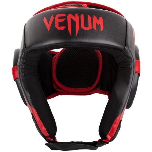 Шлем боксерский Venum Challenger 2.0 Open Face Neo Black/Red VenumБоксерские шлемы<br>Для серьезных испытаний нужен серьезный шлем, аVenum Challenger 2. 0 Open Face Neo Black/Red как раз из таких!Разработан в Тайланде из кожи Skintex, пожалуй, самый совершенный шлем по доступной цене. Ультра-легкий с превосходным обзором. Его конструкция обеспечивает полную защиту со всех сторон, включая защиту таких чувствительных областей, как виски, подбородок и щеки. Погружайтесь в игру с головой, с полностью защищенной головой!Особенности:- Построен из кожи Skintex- Ультра-легкий- Три слоя пены внутри- Защита висков, щек, ушей и подбородка- Застегивается на липучке в двух плоскостях- Единый, настраиваемый размер- Производство Китай.<br><br>Размер: Без размера (регулируется)