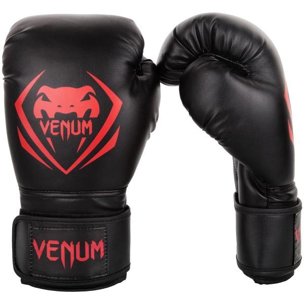 Перчатки боксерские Venum Contender Black/Red, 12 унций VenumБоксерские перчатки<br>Перчатки боксерские Venum Contender - Black/Red выдержат любой мощный удар, будь то джеб, кросс, хук или апперкот. Сделаны из 100% синтетической кожи с высоким сроком службы. Их изогнутая анатомическая форма обеспечивает гибкость и комфорт. Многослойный пенный наполнитель с легкостью поглащает все удары. Большая надежная застежка на липучке дает надежную фиксацию запястья, минимизируя риск возникновения травмы на тренировках. Отработка, спарринг, работа на мешках или лапах - боксерские перчаткиVenum Contender непременно приведут Вас к успеху!Особенности:- 100% синтетическая кожа с высоким сроком службы- многослойная пена для идеального поглощения ударов- широкая застежка на липучке для надежной фиксации запястья- большой палец полностью закреплен, что не дает его выбить<br>