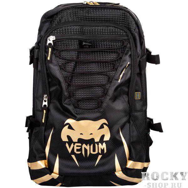Рюкзак Venum Challenger Pro Black/Gold VenumСпортивные сумки и рюкзаки<br>Рюкзак Venum Challenger Pro Black/GoldНовый уникальный многофункциональный рюкзак от Venum. Прекрасно подойдёт для переноски экипировки, использования в повседневной жизни или для походов на небольшие расстояния. Много карманов, специальное отделение для планшета или ноутбука диагональю до 17 дюймов. Также присутствует карман для MP3-плеера с отверстием для вывода наушников. Украшена логотипом Venum. Приятные бонусы:- Боковой карман с фиксацией для хранения питьевой бутылочки или шейкера- Водостойкая ткань из полиэфираОчень удобная и практичная, а главное качественная - всегда пригодится!Размер: 300 x 500 x 150 мм<br>