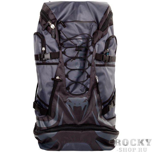 Рюкзак Venum Challenger Xtreme Grey/Grey VenumСпортивные сумки и рюкзаки<br>Рюкзак Venum Challenger Xtreme Grey/Grey - не просто рюкзак, это незаменимый спутник любого спортсмена, способный вместить в себя огромное количество одежды и самой габаритной экипировки. Просто закиньте в него все, что у вас есть и отправляйтесь на тренировку. Обратный путь же станет гораздо приятнее, так как ваши вещи будут проветриваться через специальные сетчатые вставки, что препятствует возникновению неприятного запаха и размножению бактерий. Термо-карман сохранит свежесть вашего напитка и сделает его достойной наградой после тяжелой тренировки. Рюкзак оснащен удобными боковыми карманами, флис-карманом, который не позволит вашему мобильному телефону поцарапаться, а также скрытым карманом для мп3-плеера с выводом под наушники. Плечевые ремни регулируются, а в сочетании с эргономичной формой спинки рюкзака снимают нагрузку со спины и плечей. Особенности:Водонепроницаемая тканьБольшое отделение для крупногабаритной экипировкиОбладает дополнительным отделением, которое увеличивает общий размерБоковые карманыФлисовый карман охраняет ваш телефон от царапинСетчатые панелиРегулируемые плечевые ремниРазмер: 350x630x240 сложенный и 350х880х240 разложенныйОбъем: 45 л сложенный и 63 л разложенный<br>