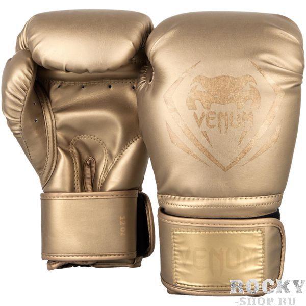 Боксерские перчатки Venum Contender Gold/Gold, 12 oz VenumБоксерские перчатки<br>Боксерские перчатки Venum Contender. Великолепное соотношение цена/качество! Отлично защищают руку! очень хорошо сидят на руке. Широкая застежка с резинкой, обеспечивает надежную фиксацию перчаток Venum на запястье. Внутренний наполнитель - пена для лучшей амортизации удара. Внешняя часть перчаток - Skintex Leather. Это современный надёжный искусственный материал. Подходят и для тренировок по боксу, мма, тайскому боксу, работы на мешках, а так же для соревнований определённого уровня.<br>