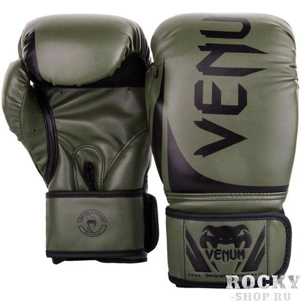 Боксерские перчатки Venum Challenger 2.0 Khaki/Black, 12 oz VenumБоксерские перчатки<br>Боксерские перчатки Venum Challenger 2. 0. Великолепное соотношение цена/качество! Отлично защищают руку! Очень хорошо сидят на руке. Широкая застежка, обеспечивает надежную фиксацию перчаток Venum на запястье. Внутренний наполнитель - пена, которая обеспечивает хорошую амортизацию удара. Внешняя часть перчаток - Skintex Leather. Это современный надёжный искусственный материал. Подходят и для тренировок по боксу, мма, тайскому боксу, работы на мешках, а так же для соревнований определённого уровня.<br>