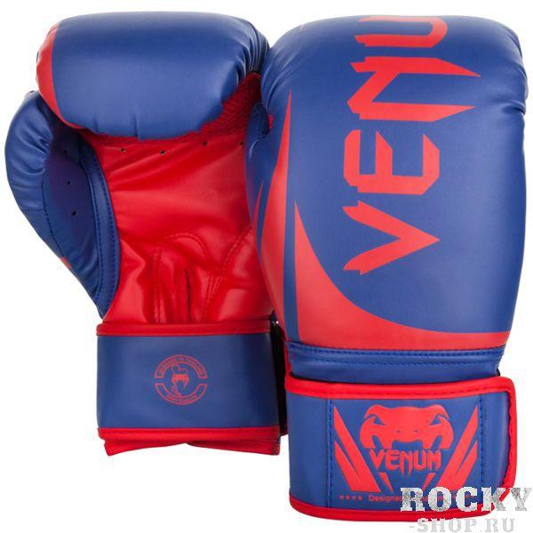 Боксерские перчатки Venum Challenger 2.0 Blue/Red-White, 12 oz VenumБоксерские перчатки<br>Боксерские перчатки Venum Challenger 2. 0. Великолепное соотношение цена/качество! Отлично защищают руку! Очень хорошо сидят на руке. Широкая застежка, обеспечивает надежную фиксацию перчаток Venum на запястье. Внутренний наполнитель - пена, которая обеспечивает хорошую амортизацию удара. Внешняя часть перчаток - Skintex Leather. Это современный надёжный искусственный материал. Подходят и для тренировок по боксу, мма, тайскому боксу, работы на мешках, а так же для соревнований определённого уровня.<br>