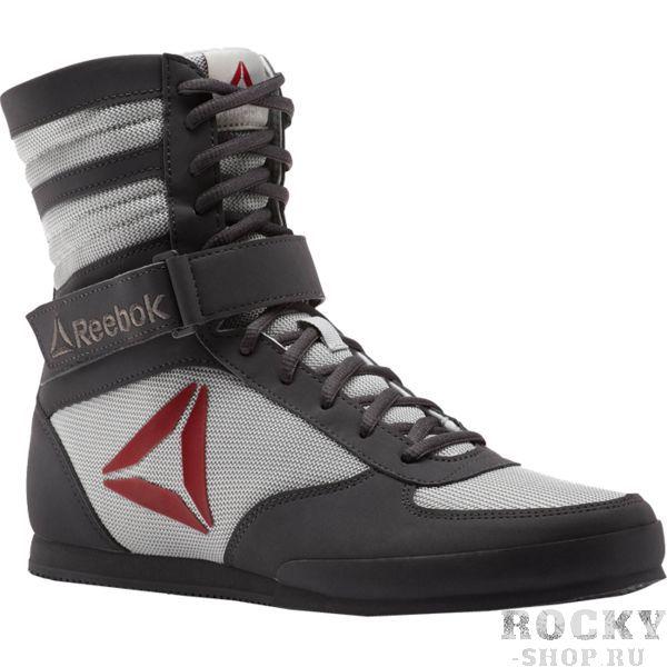 Боксёрки Reebok Boxing Boot Bk/Grey ReebokБоксерки<br>Обувь для бокса Reebok Boxing Boot. Верх из искусственного нубука для комфорта. Ремешки для идеальной посадки и надежной поддержки. Промежуточная подошва из ЭВА для амортизации. Средняя высота для поддержки щиколотки и большей устойчивости. Резиновая подошва для прочности и надежного сцепления.<br><br>Размер INT: 45