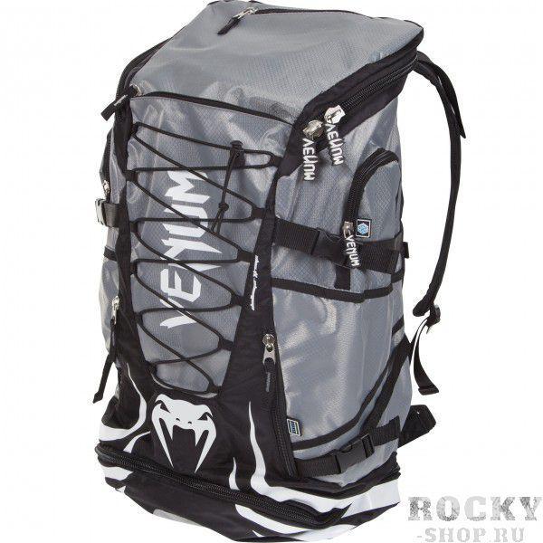 Рюкзак Venum Challenger Xtreme - Black/Grey VenumСпортивные сумки и рюкзаки<br>Новая уникальная многофункциональная сумка от Venum, прекрасно подойдёт для переноски экипировки либо хождения в поход. Много карманов, украшена логотипом Venum. Очень удобная и практичная, всегда пригодится<br>