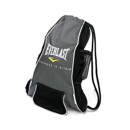 Мешок боксерский Everlast для перчаток Glove. EverlastСпортивные сумки и рюкзаки<br>Everlast Boxing and Mixed Martial Arts Glove Bag - это небольшая удобная сумка, которая специально разработана для хранения тренировочных перчаток и прочей спортивной экипировки. Антимикробная пропитка EverFresh™ вместе вентиляцией EverCool™ сохранят свежесть ваших вещей, предотвратив появление вредных бактерий и плохого запаха. Небольшой центральный карман прекрасно подходит для хранения скакалок, капы и других мелочей, в то время как боковой карман из сетки позволит без лишних усилий достать бутылочку с водой. Изготовлена из нейлона, горловина сумки затягивается шнуром.<br>