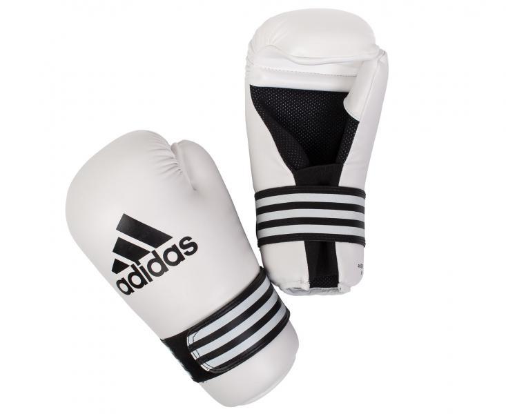 Перчатки полуконтакт Semi Contact Gloves, белые AdidasЭкипировка для кикбоксинга<br>Semi Contact Gloves. Перчатки полу контакт длякикбоксинга, каратэ, тхэквондо и других видов единоборств. Материал: полиуретан.<br><br>Размер: XS