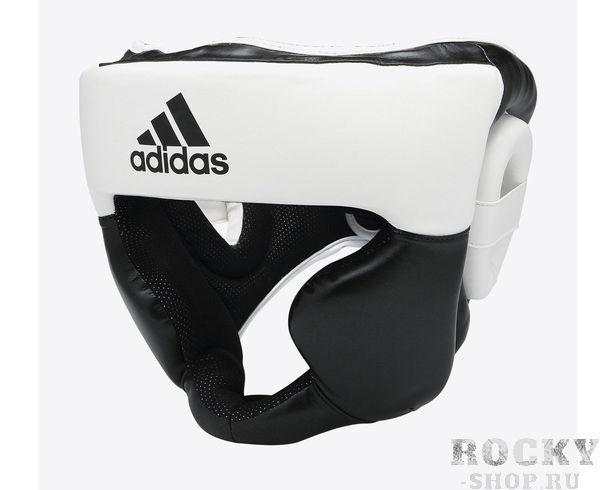 Шлем боксерский Response Standard Head Guard черно-белый, черно-белый AdidasБоксерские шлемы<br>Тренировочный закрытый боксерский шлем.Усиленная защита в области щек, ушей, скул и подбородка.Дополнительная защита ограничивает обзор. Именно поэтому в таком шлеме выступать на соревнованиях не разрешается. Подкладка выполнена из быстро высыхающего нескользящего материала. Сверху крепление с помощью резинок позволяет оптимально зафиксировать шлем на голове.Двойная система крепления на затылке позволяет подогнать шлем по размеру.<br>