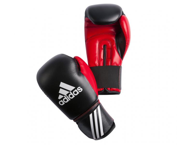 Перчатки боксерские Response, 14 унций AdidasБоксерские перчатки<br>Перчатки боксерские adidas Response черно-красные. Тренировочные боксерские перчатки на липучке. Полиуретан по технологии PU3G INNOVATION. Композитный литой вкладыш из пены высокого давления. Усиленная защита большого пальца, ладони, уcиление ударной зоны. Специальная жесткая манжета для защиты кисти.<br><br>Цвет: красно-белые