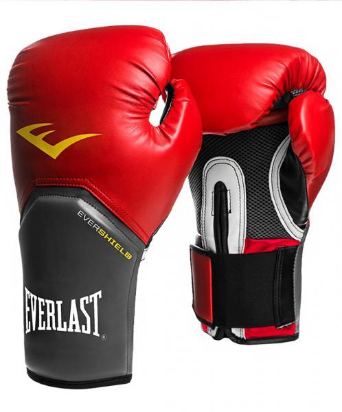 Перчатки боксерские Everlast Pro Style Elite, 16 OZ EverlastБоксерские перчатки<br>Everlast Pro Style Elite Training Gloves — тренировочные боксёрские перчатки для спаррингов и работы на снарядах. Изготовлены из качественной искусственной кожи с применением технологий Everlast, использующихся в экипировке профессиональных спортсменов. Благодаря выверенной анатомической форме перчатки надёжно фиксируют руку и гарантируют защиту от травм. Нижняя часть, полностью изготовленная из сетчатого материала, обеспечивает циркуляцию воздуха и препятствует образованию влаги, а также неприятного запаха за счёт антибактериальной пропитки EVERFRESH. Комбинация лёгких дышащих материалов поддерживает оптимальную температуру тела. Модель подходит для начинающих боксёров, которые хотят тренироваться с экипировкой высокого класса.<br><br>Цвет: красный