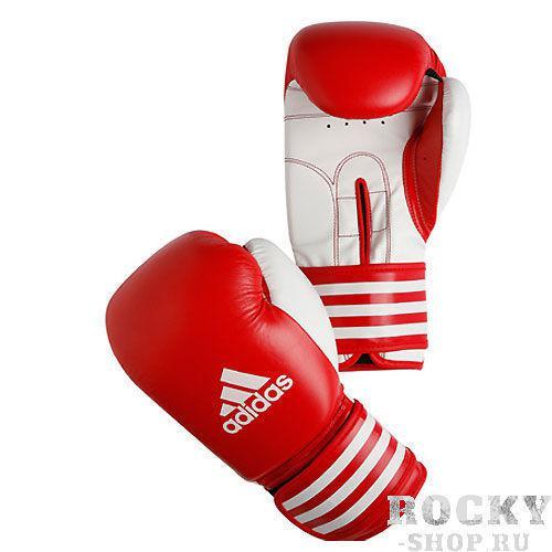 Перчатки боксерские Ultima, 14 унций AdidasБоксерские перчатки<br>Высокая  плотность внутреннего наполнителя<br> Материал - искусственная кожа<br> Эргономичный  дизайн и продуманный крой<br> Система  обеспечения циркуляции кислорода CLIMA COOL<br> Застёжка  липучка из искусственного материала оптимальной жёсткости<br> Удобная  фирменная упаковка<br><br>Цвет: красно-белые