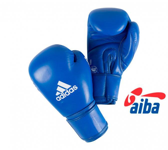 Перчатки боксерские AIBA Сertifited, 12 унций AdidasБоксерские перчатки<br>Сертифицированы International Boxing Association<br> 100%  100% кожа наивысшего качества<br> Фиксированный  палец, противостоит образованию травм<br> Застёжка  липучка<br> Мягкая  искусственная подстежка, с влагопроводящими свойствами<br><br>Цвет: синие