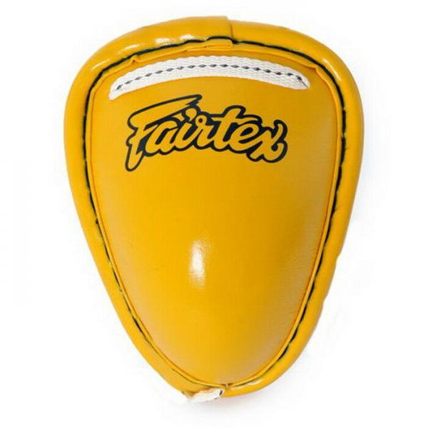 Защита на пах Fairtex, S FairtexЗащита тела<br>Защита паха Fairtex представляет собой металлическую ракушку обтянутую кожей. Крепится с помощью завязок. Защита применима во всех типах ударных единоборств (муай-тай, кикбоксинг, рукопашный бой и др.)Ручная работа.Страна производитель: Таиланд.Цвет: желтый<br>