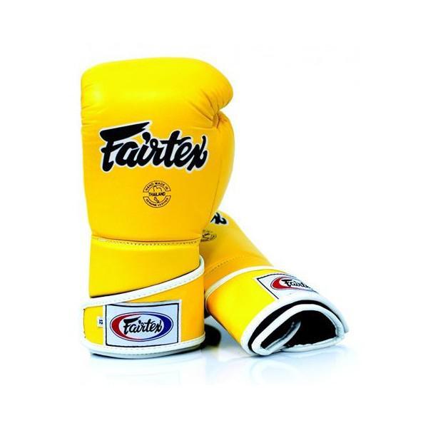Тренировочные перчатки на липучке Fairtex, 12oz FairtexБоксерские перчатки<br>Трехслойная система защиты вокруг ударной части руки погашает удар и защищает от повреждений кисти. Увеличенный фиксация перчатки в области кисти для уменьшения риска получения травмы запястья. Сшитые из кожи класса  премиум.  Закрытый дизайн пальца перчаток STYLISH ANGULAR SPAR, чтобы снизить травмы глаза и большого пальца. Размер: 12 oz Цвет: черный, желтый.  Производство: Таиланд.<br><br>Цвет: Желтый