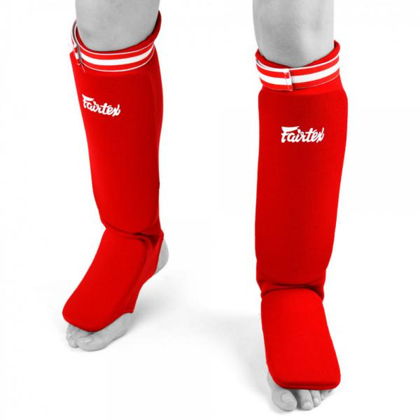 Защита на ноги для соревнований с чулком Fairtex FairtexЗащита тела<br>Данная модель защиты допускается на соревнованиях по: Боевому Самбо, К-1, Кикбоксингу, Муай Тай, Рукопашному бою. Эластичный чулок полностую облегает ногу. Толщина защитной вставки 20мм. Эластичная резинка на липучке уменьшает возможность соскальзывания щитка с ноги. Сделано в Таиланде. Материал - эластан. Размер - Free Size (средний). Цвет - красный, синий.<br><br>Цвет: Красный